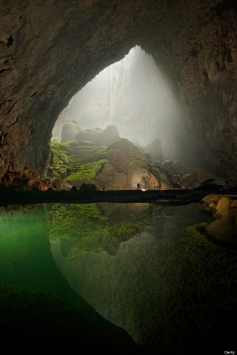 A rock formation shines beneath a skylight in Hang Son Doong.