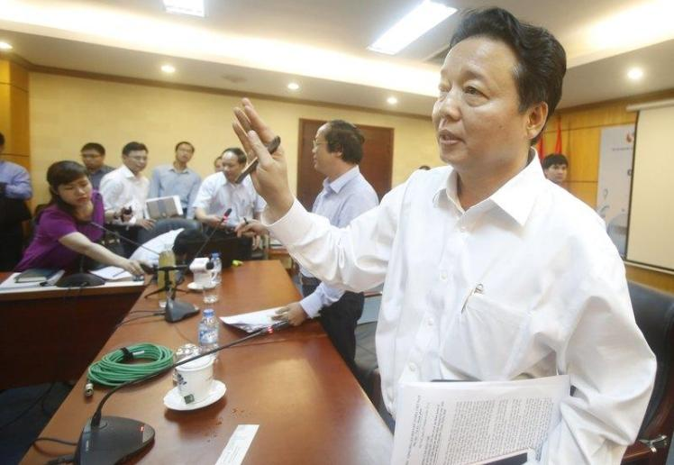Ha gestures while leaving a meeting in Hanoi