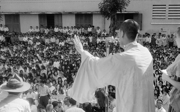 Buddhist Monk Speaking to Crowd